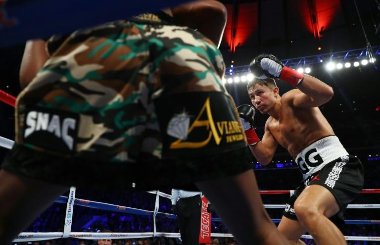 Gennady Golovkin knocks down Daniel Jacobs in the fourth round during their Championship fight for Golovkin's WBA/WBC/IBF middleweight title, at Madison Square Garden in New York, on March 18, 2017