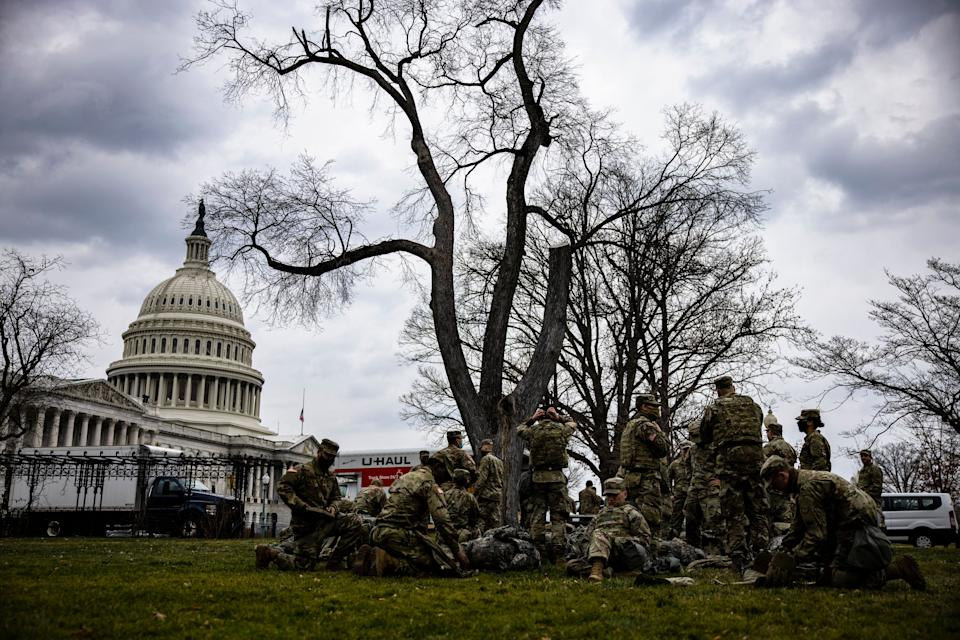 National Guard troops are seen on the lawn of the U.S. Capitol on Jan. 15. (Photo: Samuel Corum via Getty Images)