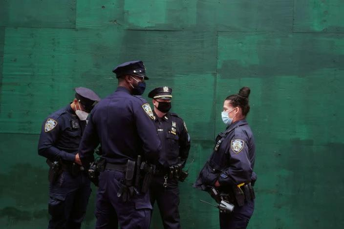 FILE PHOTO: Police officers stand in Times Square in New York City