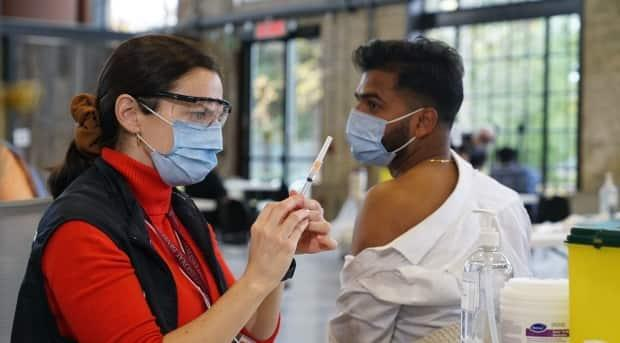 Running busier-than-usual flu clinics in 2020 added to the demands on Ottawa Public Health staff.