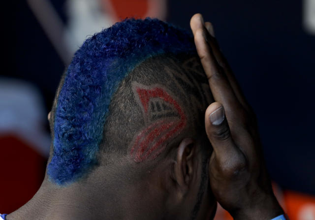 Yasiel Puig wipes his face in the dugout before Game 1 of the World Series vs. the Houston Astros. (AP Photo/Matt Slocum)