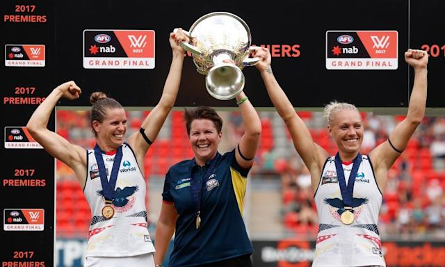 "<span class=""element-image__caption"">Chelsea Randall, Bec Goddard (coach) and Erin Phillips of the Crows hold the premiership cup aloft after winning the inaugural AFLW grand final against Brisbane.</span> <span class=""element-image__credit"">Photograph: Michael Willson/AFL Media/Getty Images</span>"