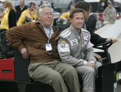 FILE - In this May 14, 2008, file photo, John Andretti, right, rides out to the pit area with his father, Aldo Andretti, for practice for the Indianapolis 500 auto race at Indianapolis Motor Speedway in Indianapolis. Mario Andretti feels the same pain as so many others these days. His wife died two years ago, long before the pandemic. And his beloved nephew John lost a brutal battle with colon cancer. But then COVID-19 claimed his twin brother Aldo and one of the greatest racers of all time is not immune from the loneliness and depression sweeping the world. (AP Photo/AJ Mast, File)