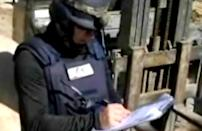 In this photo made from video released late Thursday, Oct. 24, 2013 by the Syrian official news agency SANA, a chemical weapons expert works at a chemical weapons plant at an unknown location in Syria. Norway has turned down a U.S. request to receive the bulk of Syria's chemical weapons for destruction because it doesn't have the capabilities to complete the task by the deadlines given, the Norwegian foreign minister said Friday. (AP Photo/SANA)