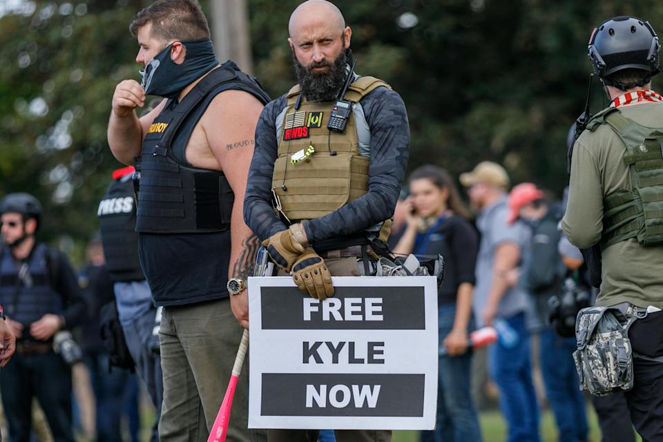Kyle Rittenhouse's name displayed at a Proud Boys rally in Oregon (Anadolu Agency via Getty Images)