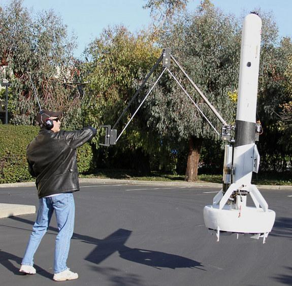 Hovering Drone Grabs Spotlight with 6-Foot Arm