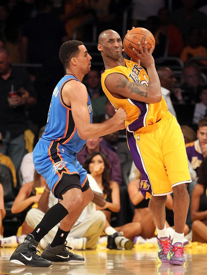 LOS ANGELES, CA - MAY 19:  Kobe Bryant #24 of the Los Angeles Lakers posts up Thabo Sefolosha #2 of the Oklahoma City Thunder in the third quarter in Game Four of the Western Conference Semifinals in the 2012 NBA Playoffs on May 19 at Staples Center in Los Angeles, California. NOTE TO USER: User expressly acknowledges and agrees that, by downloading and or using this photograph, User is consenting to the terms and conditions of the Getty Images License Agreement.  (Photo by Stephen Dunn/Getty Images)