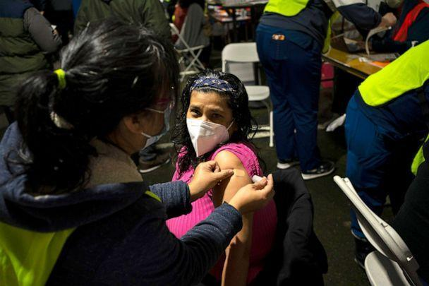 PHOTO: Miriam Olloa gets a bandage after receiving a COVID-19 vaccination on Feb. 4, 2021 in Federal Way, Washington. Swedish Medical Center held a mobile vaccination clinic at the Pacific Islander Community Association of Washington. (David Ryder/Getty Images)