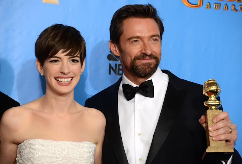 """Actors Anne Hathaway, left, and Hugh Jackman pose with the award for best motion picture comedy or musical for """"Les Miserables"""" backstage at the 70th Annual Golden Globe Awards at the Beverly Hilton Hotel on Sunday Jan. 13, 2013, in Beverly Hills, Calif. (Photo by Jordan Strauss/Invision/AP)"""
