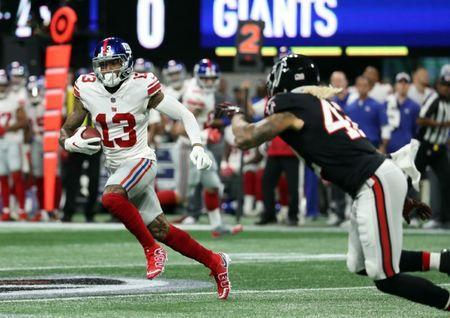Oct 22, 2018; Atlanta, GA, USA; New York Giants wide receiver Odell Beckham (13) runs after a catch in the first quarter against the Atlanta Falcons at Mercedes-Benz Stadium. Mandatory Credit: Jason Getz-USA TODAY Sports