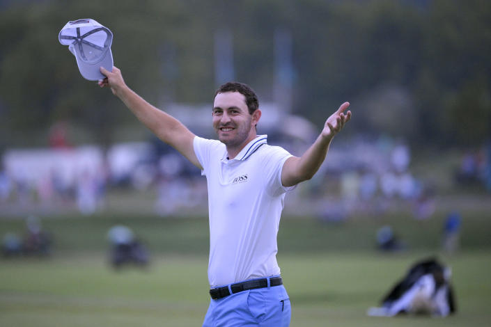 Patrick Cantlay reacts after sinking in his putt on the 18th green, the sixth playoff hole of the final round of the BMW Championship golf tournament, Sunday, Aug. 29, 2021, at Caves Valley Golf Club in Owings Mills, Md. (AP Photo/Nick Wass)