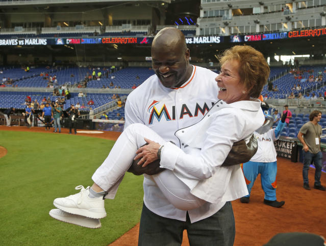 Shaquille O'Neal and Judge Judy: MLB's newest power couple. (AP Photo)