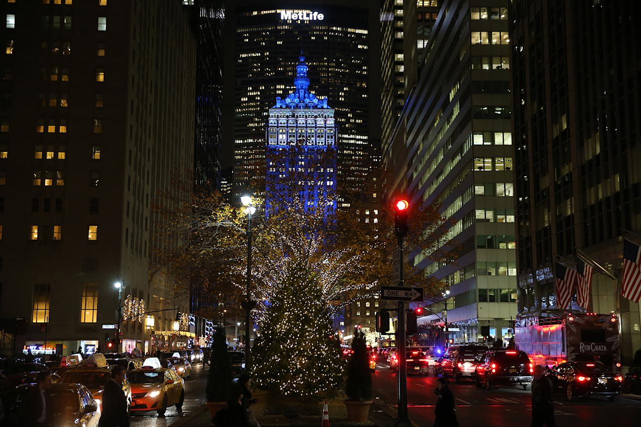 <p>Christmas lights cover the trees on the Park Ave. mall in front of the Helmsley Building in New York City. (Gordon Donovan/Yahoo News) </p>