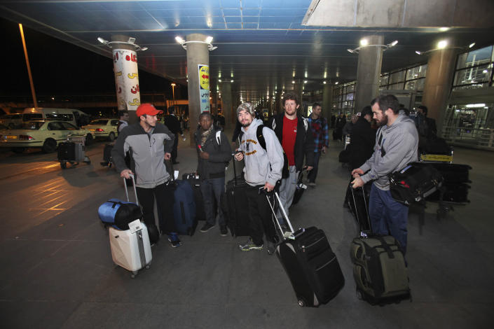 U.S. freestyle wrestling team members prepare to leave Tehran's Imam Khomeini airport in Iran after their arrival on early Tuesday morning, Feb. 19, 2013, to attend World Cup tournament. USA Wrestling has formalized plans for a committee charged with restoring Olympic wrestling. (AP Photo/Vahid Salemi)