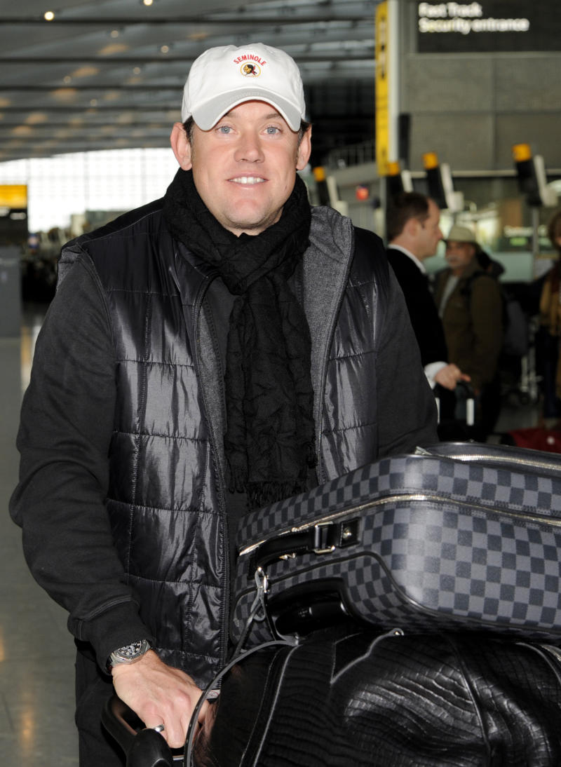 The new world's number one golfer England's Lee Westwood, walks through Heathrow Airport in London en-route to Shanghai China Monday Nov. 1, 2010. Westwood assumed the top ranking Sunday to end a record run by Tiger Woods, who had been the world's No. 1 golfer for 281 weeks.(AP Photo)  **  UNITED KINGDOM OUT NO SALES NO INTERNET NO MAGS  **