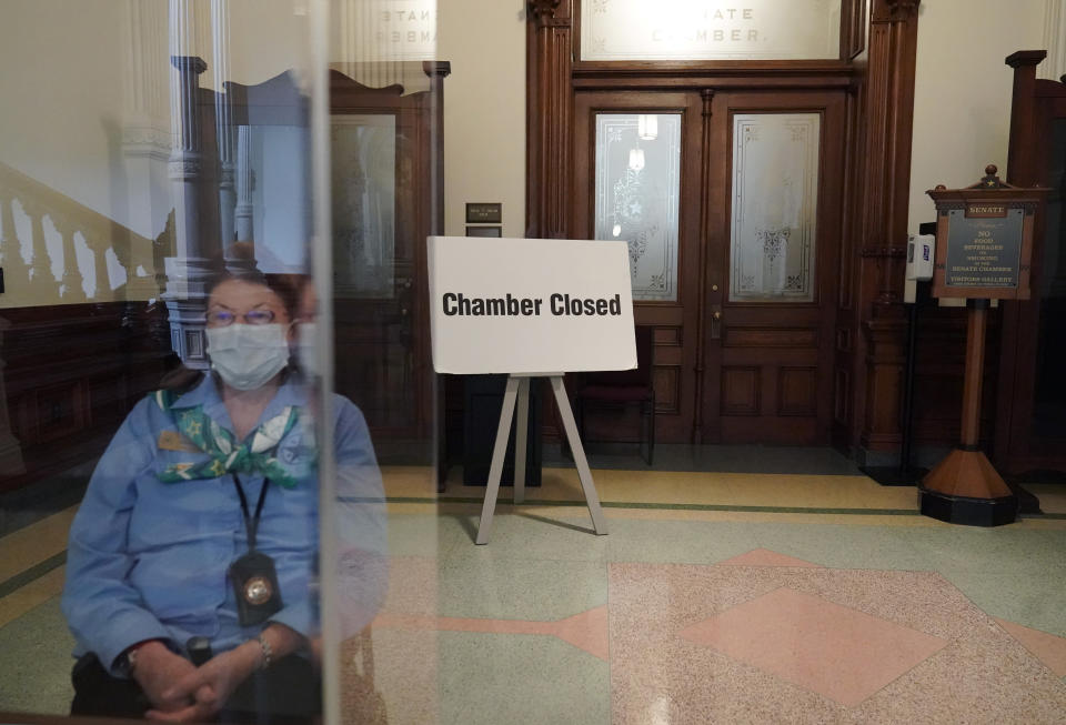 """A """"Chamber Closed"""" sign blocks the entry to the Senate floor at the State Capitol, Tuesday, June 1, 2021, in Austin, Texas. The Texas Legislature closed out its regular session Monday, but are expected to return for a special session after Texas Democrats blocked one of the nation's most restrictive new voting laws with a walkout. (AP Photo/Eric Gay)"""