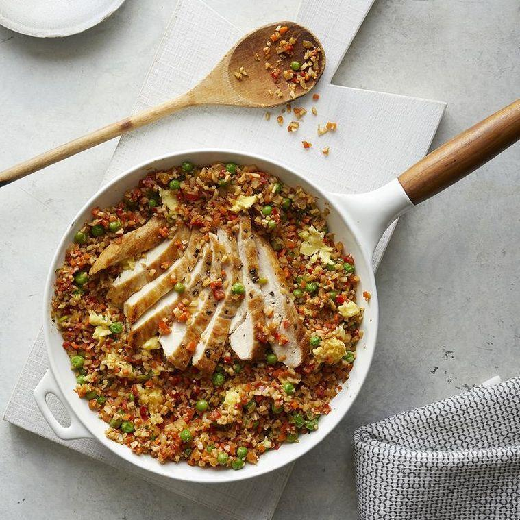 "<p>You won't believe how close this gets to the real thing — without a single grain in sight.</p><p><em><a href=""https://www.prevention.com/food-nutrition/recipes/a28353543/cauliflower-chicken-fried-rice-recipe/"" rel=""nofollow noopener"" target=""_blank"" data-ylk=""slk:Get the recipe from Prevention »"" class=""link rapid-noclick-resp"">Get the recipe from Prevention »</a></em></p>"