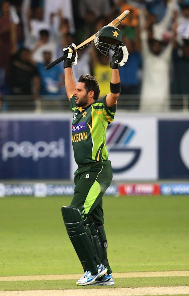DUBAI, UNITED ARAB EMIRATES - DECEMBER 11:  Shahid Afridi of Pakistan celebrate after hitting the winning runs during the first Twenty20 International match between Pakistan and Sri Lanka at Dubai Sports City Cricket Stadium on December 11, 2013 in Dubai, United Arab Emirates.  (Photo by Francois Nel/Getty Images)