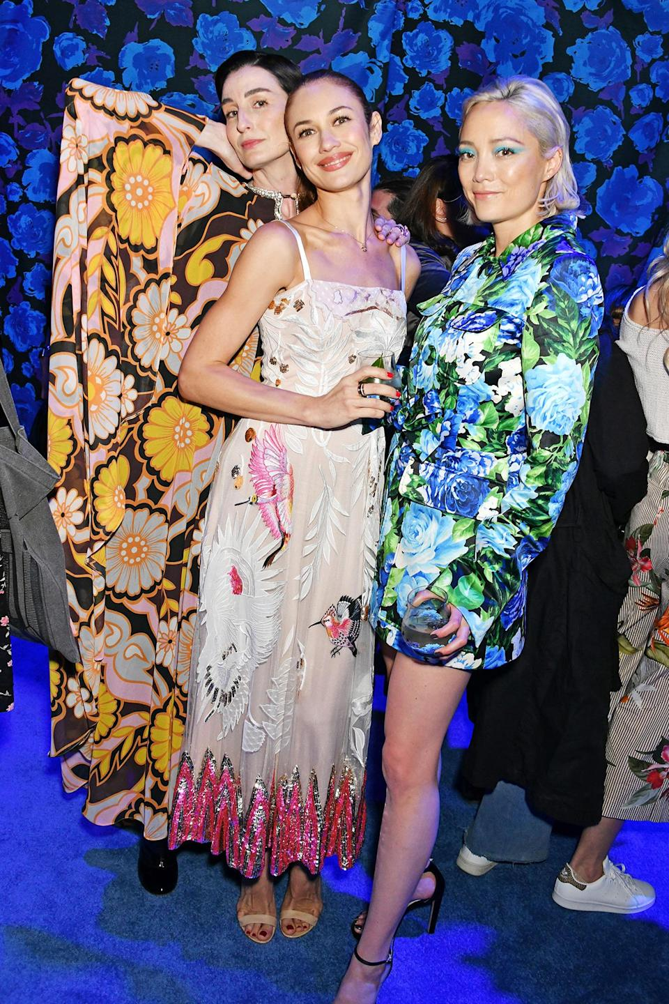 <p>Erin O'Connor, Olga Kurylenko and Pom Klementieff brighten the night at the Richard Quinn spring/summer 2022 fashion show and cocktail party at The Londoner Hotel on Sept. 21. </p>