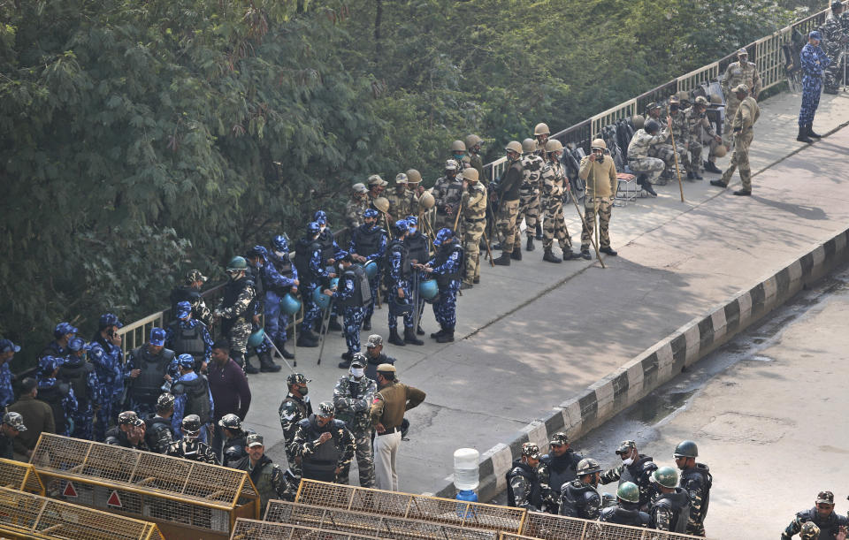 Indian para-military force soldiers stand guard at Delhi-Utttar Pradesh border, in New Delhi, India, Tuesday, Feb. 2, 2021. Indian authorities Tuesday heavily ramped up security along three main protest sites outside New Delhi's border, using cemented iron spikes, steel barricades and deployed hundreds of police in riot gear in their latest attempt to thwart the growing farmers' protest on the edges of the capital. (AP Photo/Manish Swarup)
