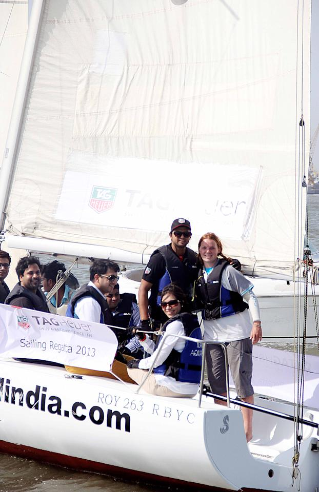 Suresh Raina poses with a fan at a boating race held at the Gateway of India