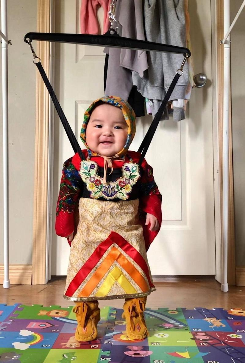 Six-month-old Brave Yazzie of Onion Lake, Sask. gets ready for a dance session. (Photo: Courtesy Aislinn Whitstone)