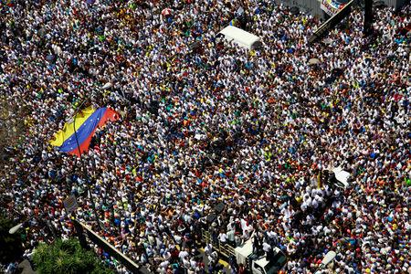Supporters of Venezuelan opposition leader Juan Guaido, who many nations have recognized as the country's rightful interim ruler, take part in a rally against Venezuelan President Nicolas Maduro's government in Caracas, Venezuela, April 6, 2019. REUTERS/Adriana Loureiro