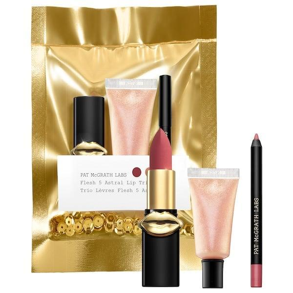 <p>Layer the products in this new <span>Pat McGrath Labs Mini Flesh 5 Astral Trio</span> ($25) for a pretty pink lip topped with a hint of iridescent shine.</p>