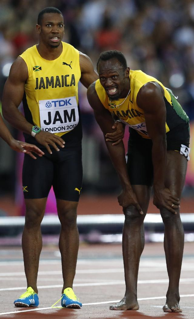 Athletics - World Athletics Championships - Men's 100 Metres Relay Final - London Stadium, London, Britain – August 12, 2017. Yohan Blake and Usain Bolt of Jamaica react after the final. REUTERS/Phil Noble