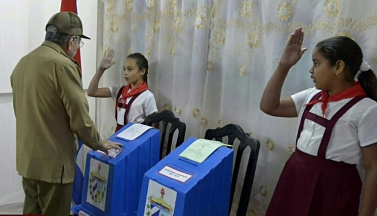 Cuban President Raul Castro casts his ballot ratifying a new National Assembly that will choose his successor, a major transition for a country led by Castros for nearly 60 years