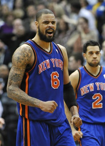New York Knicks' Tyson Chandler celebrates a basket in the second half of an NBA basketball game against the Minnesota Timberwolves, Saturday, Feb. 11, 2012, in Minneapolis. The Knicks won 100-98. Knicks' Landry Fields, right, who scored 19 points. (AP Photo/Jim Mone)