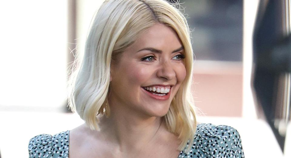 Holly Willoughby inspires our summer wardrobe in green floral dress on 'This Morning'.  (Getty Images)