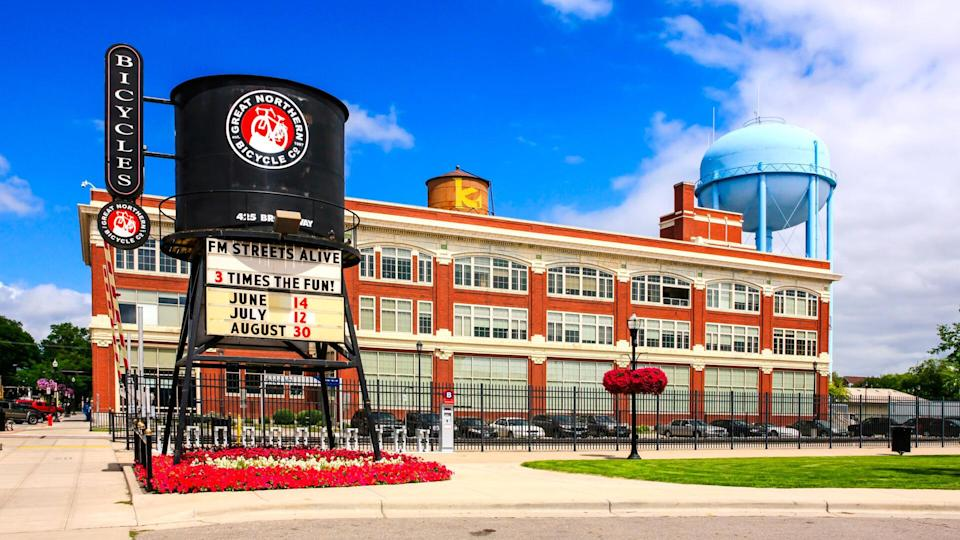Fargo, ND, USA - July 24, 2015: The old railway water tower advertising the Great Northern Bicycle Co in front the Fargo-Moorhead complex in downtown Fargo N.