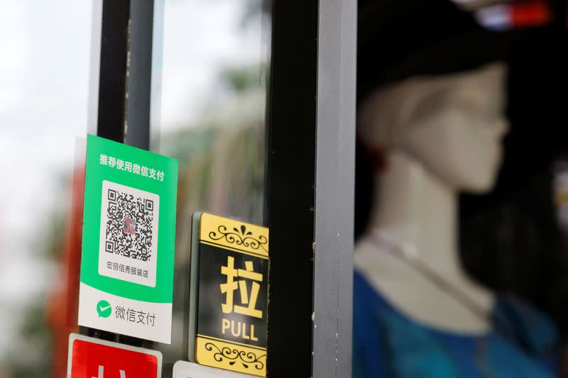 A QR code of the digital payment service WeChat Pay is seen at a shop, in Beijing