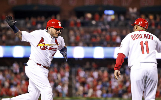 St. Louis Cardinals' Yadier Molina, left, is congratulated by third base coach Jose Oquendo after hitting a three-run home run during the fourth inning of a baseball game Tuesday, Sept. 25, 2018, in St. Louis. (AP Photo/Jeff Roberson)