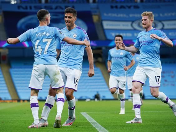 Phil Foden of Manchester City celebrates with Rodrigo and Kevin De Bruyne (2020 Pool)