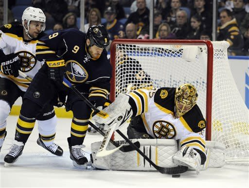 Buffalo Sabres' center Steve Ott (9) battles for a rebound against Boston Bruins' goaltender Anton Khudobin, (35), of Kazakhstan, during the first period of an NHL hockey game in Buffalo, N.Y., Friday, Feb. 15, 2013. (AP Photo/Gary Wiepert)