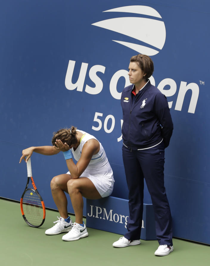 Barbora Strycova, of the Czech Republic, takes a seat next to an official during the third round of the U.S. Open tennis tournament against Elise Mertens, of Belgium, Friday, Aug. 31, 2018, in New York. (AP Photo/Seth Wenig)