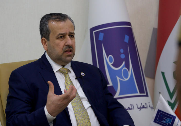 Judge Jaleel Adnan Khalaf, chairman of the Iraqi Independent High Electoral Commission, speaks during an interview with The Associated Press, Tuesday, Sept. 14, 2021, in Baghdad, Iraq. Iraq has identified and thwarted attempts of voter fraud less than one month before Iraq is set to hold federal polls including the selling of votes and intimidation using arms, the head of Iraq's electoral commission said. (AP Photo/Hadi Mizban)