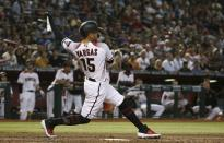 Arizona Diamondbacks' Ildemaro Vargas watches the flight of his two-run double against the Los Angeles Dodgers during the fifth inning of a baseball game Wednesday, June 26, 2019, in Phoenix. (AP Photo/Ross D. Franklin)