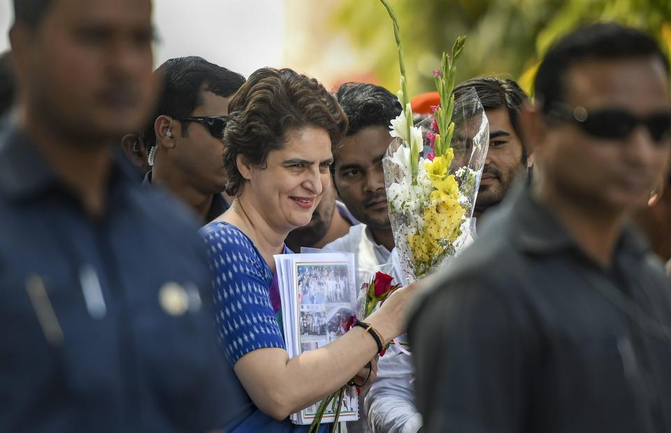 Congress General Secretary UP-East Priyanka Gandhi Vadra is greeted by party leaders and workers on her arrival at the airport in Lucknow on 27 March.