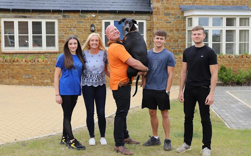 Steve Cummings and dog Bella photographed with his family (L-R) Saskia, Claire, Hayden and Bradley at their home near Banbury in Oxfordshire. - John Lawrence