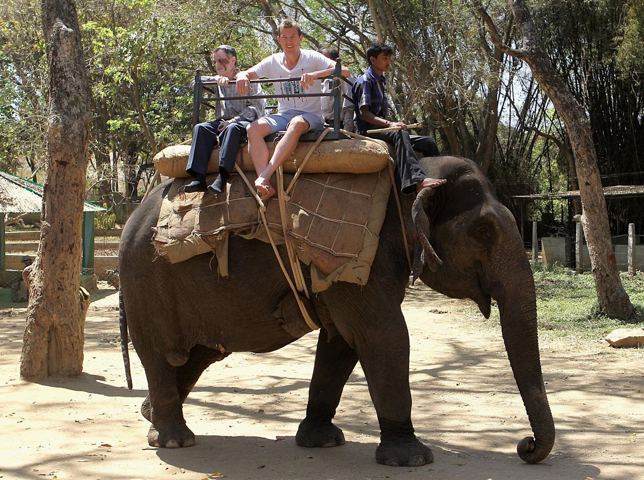 BANGALORE, INDIA - MARCH 12:  Brett Lee of Australia rides on an Indian elephant during a visit to the Bannerghatta Biological Park on March 12, 2011 in Bangalore, India.  (Photo by Hamish Blair/Getty Images)