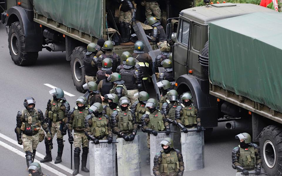 Belarusian riot police officers are generally well paid and have access to subsidised loans and housing - AP Photot