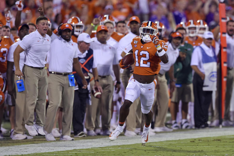Clemson's K'Von Wallace races down the sideline for a touchdown with an interception during the first half of the team's NCAA college football game against Charlotte on Saturday, Sept. 21, 2019, in Clemson, S.C. (AP Photo/Richard Shiro)