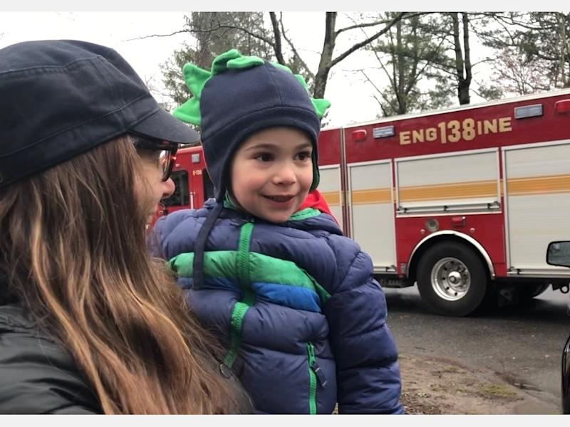 5-year-old Bruno Palermo getting a lift from mom Danielle for a better view of the fire trucks of the Golden's Bridge Fire Department during the surprise birthday drive-by.