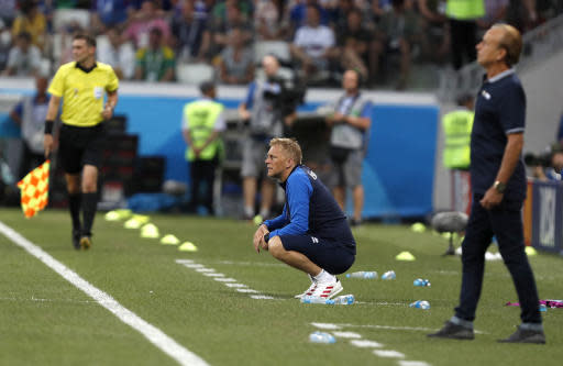 Iceland coach Heimar Hallgrimsson, centre, watches play during the group D match between Nigeria and Iceland at the 2018 soccer World Cup in the Volgograd Arena in Volgograd, Russia, Friday, June 22, 2018. (AP Photo/Darko Vojinovic)