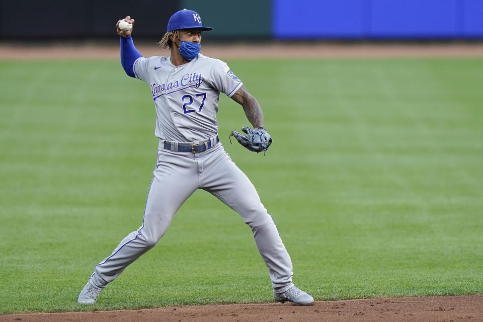 Kansas City Royals shortstop Adalberto Mondesi (27) throws the ball to first base for an out during the first inning of a baseball game against the Cincinnati Reds at Great American Ballpark in Cincinnati, Tuesday, August 11, 2020. (AP Photo/Bryan Woolston)