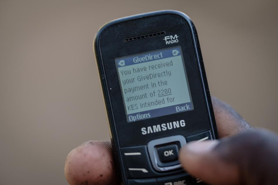 A mobile phone message confirming a universal basic income transaction in the Bondo region of western Kenya. The nonprofit GiveDirectly has been running a UBI program in the area since 2016. Credit: Yasuyoshi Chiba/AFP/Getty Images (Photo: )