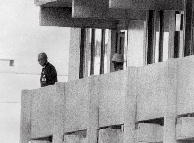 FILES - Picture taken on September 5, 1972 shows a Palestinian guerilla member (C) appearing on the balcony of the Israeli house watching an official (L) at the Munich Olympic village. As German magazine